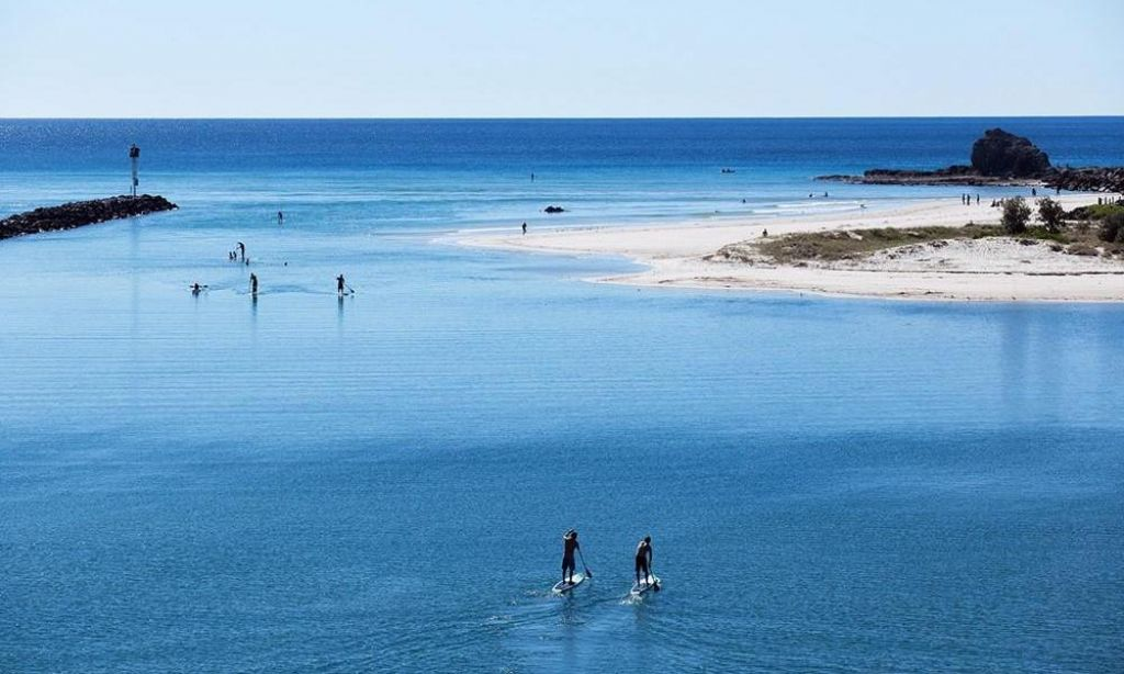 Paddle boarding Currumbin Creek in Queensland, Australia. | Photo Courtesy: Nick King