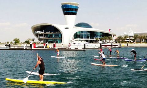 Stand up paddle board racers off the gates in the first stop of the Abu Dhabi SUP Race Series, United Arab Emirates.
