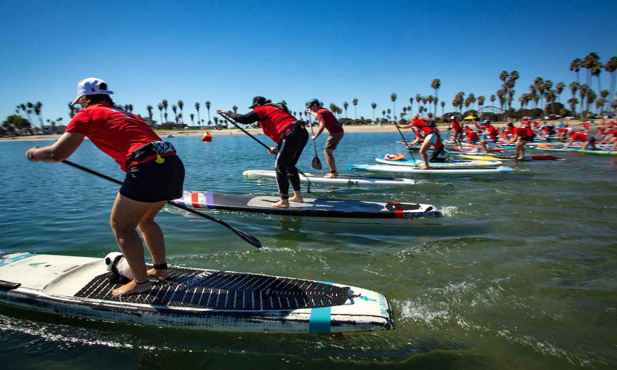 Panda Paddle event participants in Bonita Cove, California, United States. | © Day's Edge Productions