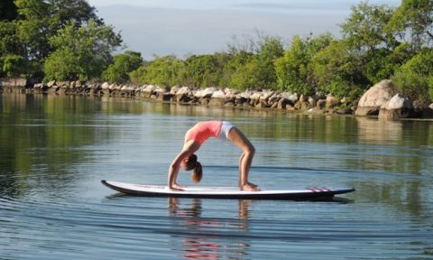 5 Reasons To Take Your Yoga Off The Mat And Onto A Paddleboard